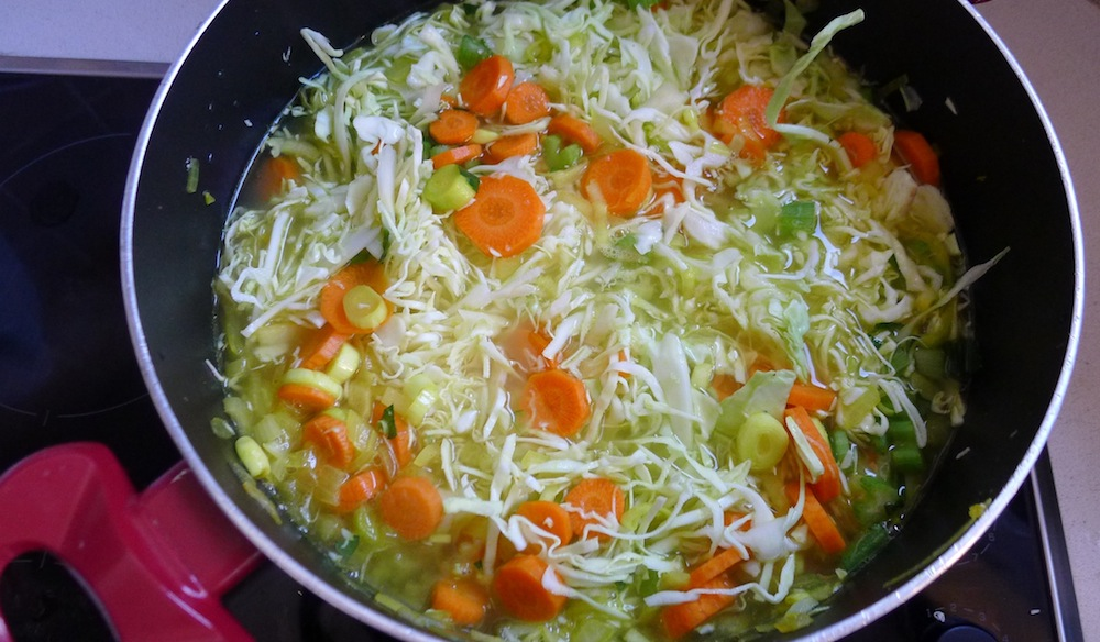 Finally, add the grated cabbage and water