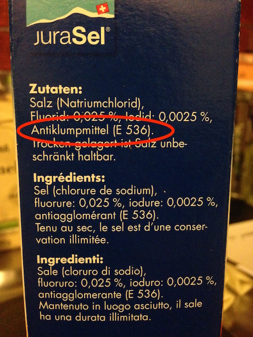 Here is an example of a sea salt from Holland containing  E536 or Potassium ferrocyanide. (This salt also has added fluoride, another reason to avoid!)